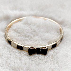 Kate Spade Take A Bow Gold Tone Bangle Bracelet - Black White